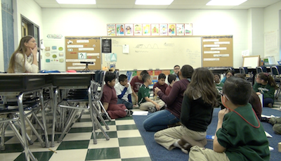 Tarkington's Sheri Roney (far left) listens as her students lead a whole-class discussion about sound waves. Note how Sheri still appears engaged in the discussion even as she sits well away from the circle.