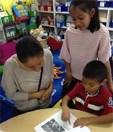 Student celebrates his writing with his family.