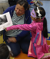 Super reader teachers her mom how she uses pointer power when she reads