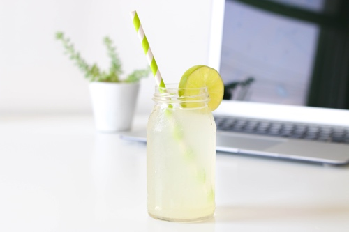 Laptop with a cool summer drink in front