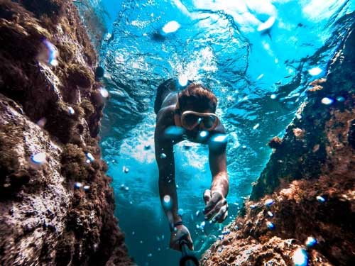 Woman diving in a reef