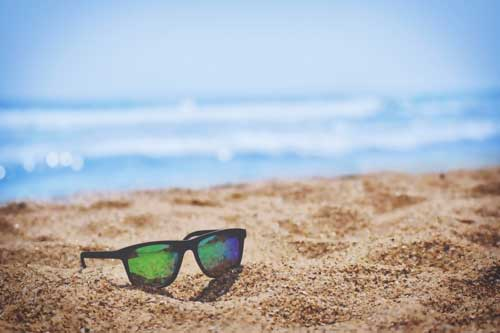 Beach with Sunglasses in the Sand